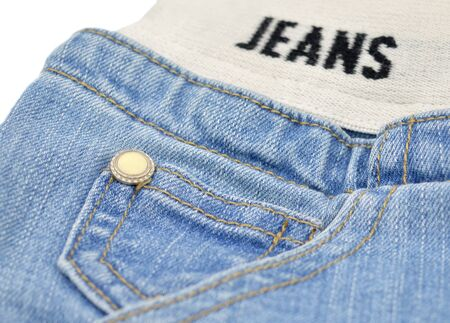 Blue jeans small pocket with yellow button and stretching belt. Zdjęcie Seryjne
