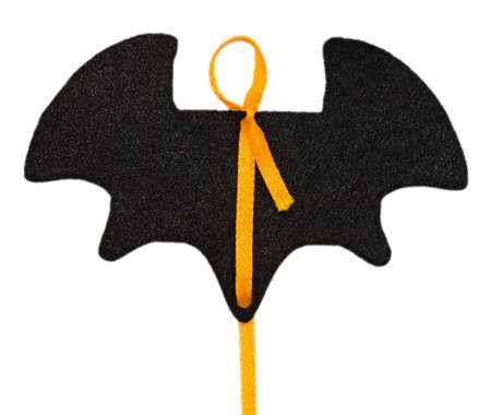 Black felt Halloween bat tag with yellow ribbon isolated on white background.