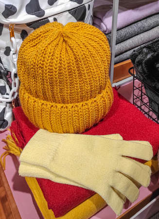 Yellow knit hat, gloves and scarves in wardrobe.