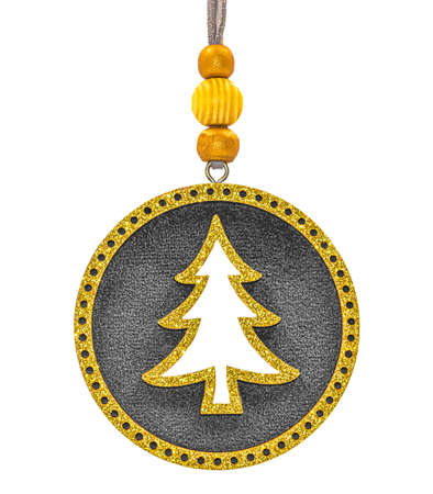 Round Christmas tree decoration with golden glittering borders and Christmas tree in center isolated on white background.