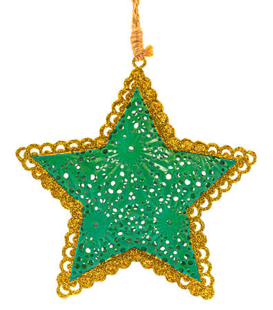 Green metal Christmas tree decoration in shape of five-pointed star with golden glittering borders hanging in rope isolated on white background.