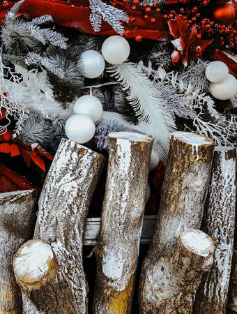 Christmas tree with decorations behind log fence. Stok Fotoğraf