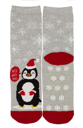 Gray and red Christmas winter socks with penguin isolated on white background.