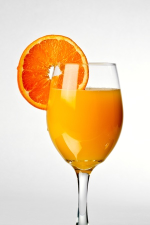 fresh squeezed orange juice with slice of orange