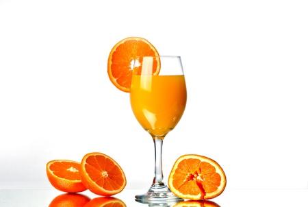 fresh squeezed orange juice with orange halves