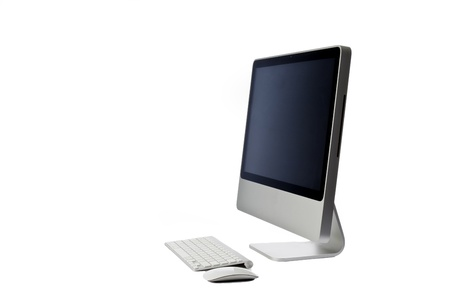Modern looking all in one computer isolated against a white background with keyboard and mouse