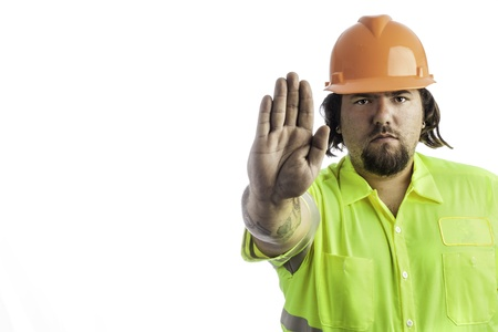 City construction worker isolated on white with his hand out showing stop Stock Photo - 16882436