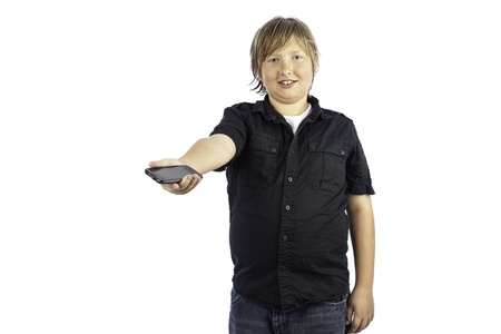 Young boy isolated on white holding out a cell phone