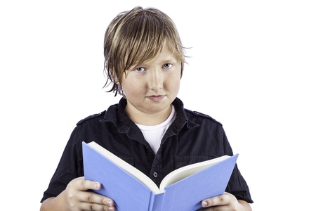 Young boy isolated on white holding an open book
