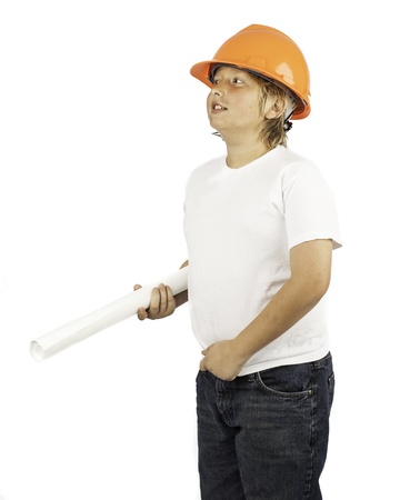A young boy isolated on white in a hard hat holding building plans Stock Photo - 16882443