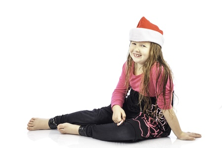 Young girl isolated on white wearing a santa hat Stock Photo