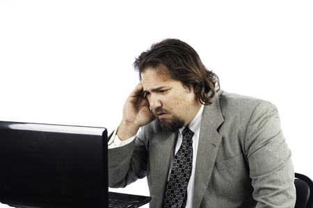 A sad looking business man isolated on white with a laptop Stock Photo - 16885633