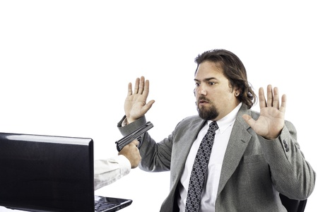 a gun coming out of a computer holding up a business man Stock Photo - 16885626