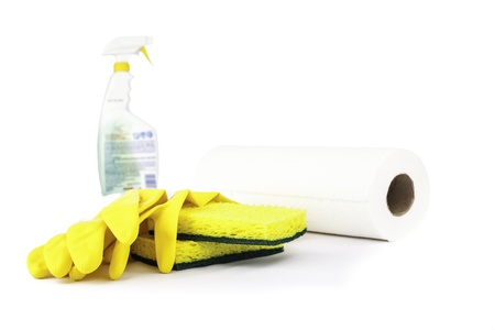 Cleaning supplies on white with a blurred spray bottle in the back Stock Photo - 16890214