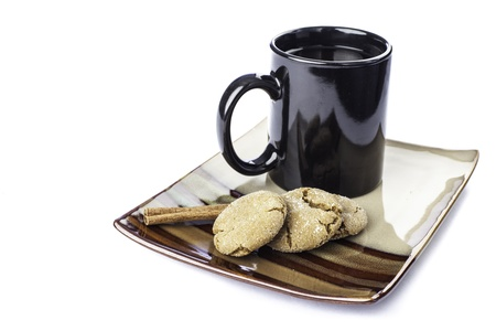 pretty plate of ginger molasses cookies with a cup of coffee