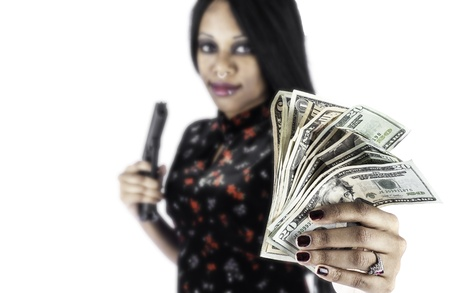 african american woman: A sexy african american woman holding a gun and a wad of cash could symbolize crime or protection