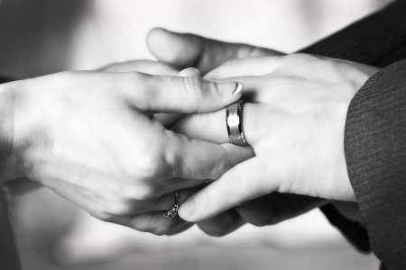 black and white photo of a man and woman putting on wedding rings Stock Photo - 16976184