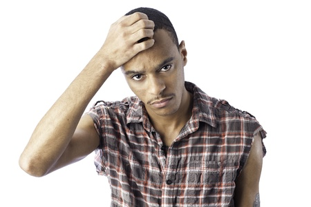 Isolated young african american black male with an expression for either pain, sorrow, headache, thinking or sadness.  Stock Photo - 17232545