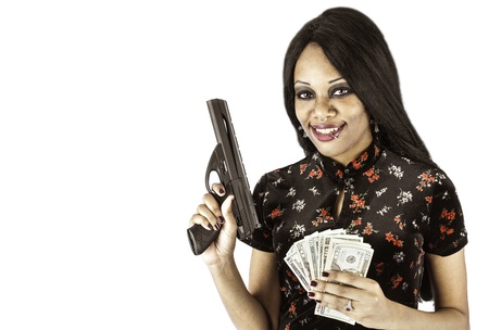 A sexy african american woman holding a gun and a wad of cash could symbolize crime or protection Stock Photo - 17232555