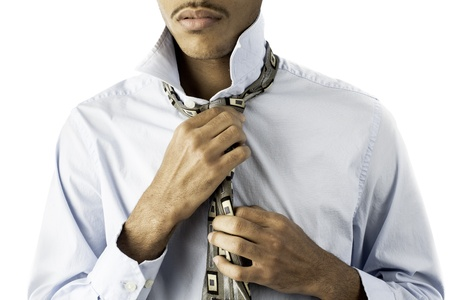 isolated shot showing a young african american black male finishing tying a tie. Stock Photo - 17232557