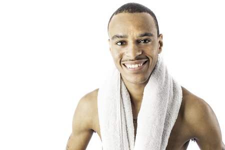 hygeine: isolated photo of a sexy young african american black male holding a towel can be used for health, exercise or hygeine.
