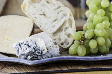 Rustic bread with assorted cheeses and grapes