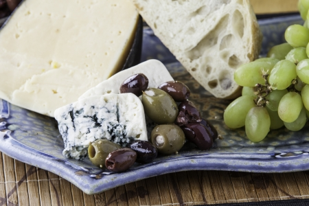 Assorted rustic bread with assorted olives and cheese