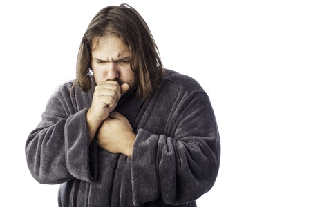 isolated sick man bundled up in a robe coughing Stock Photo - 17526935