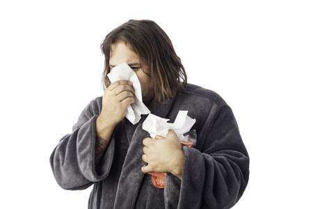isolated sick man bundled up in a robe sneezing into a tissue Stock Photo - 17539269
