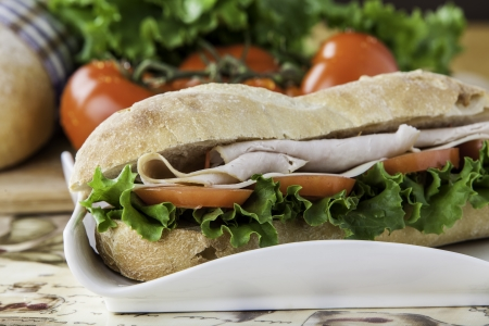 close up of a turkey sub with tomato, lettuce and cheese Stock Photo