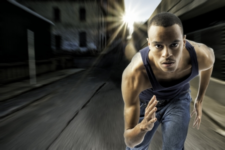 horizontal shot of black african american male running Stock Photo