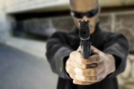 african american young black male hold a gun photo