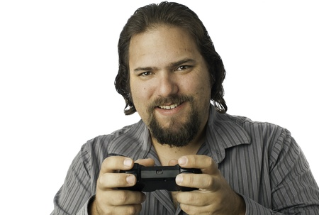 Young white male using a video game controller with a smile Stock Photo - 17539262