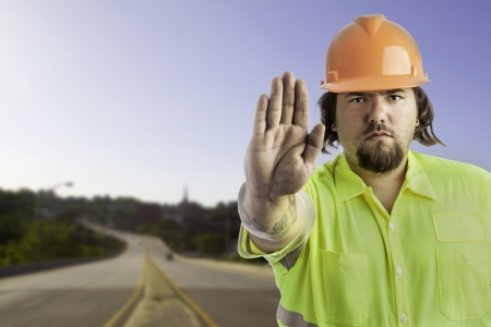 City construction worker isolated on white with his hand out showing stop Stock Photo - 17539283