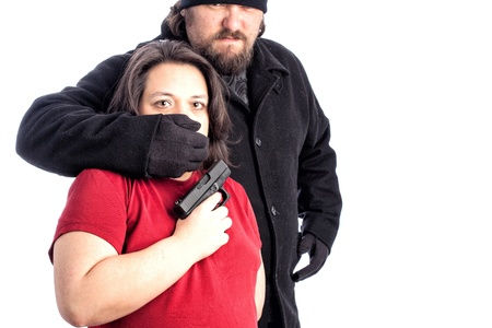 Isolated photo of a woman in red shirt being assaulted from behind by a white male in a black coat photo
