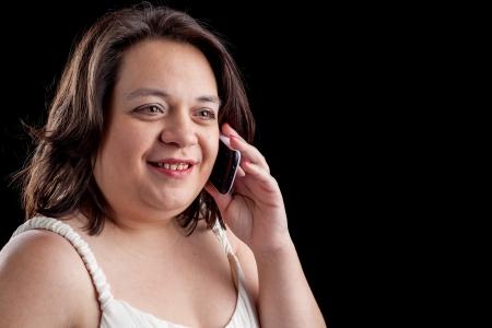 hispanic woman using a cell phone Stock Photo - 17539250