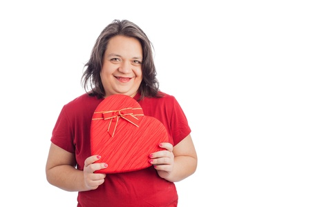 Hispanic woman holding heart shaped box on white with space for text