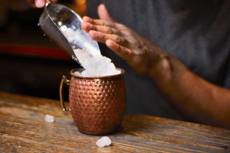 bartender adding ice slush Stock Photo