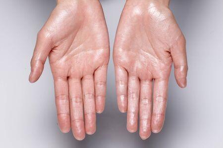 glossy hand. wet hands.