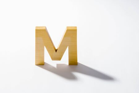 Wooden Alphabet M and Shadow Reflection.