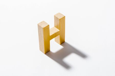 Wooden Alphabet H and Shadow Reflection. Imagens