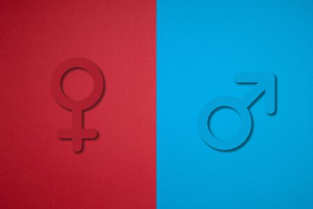 male and female gender symbols made by cutting paper.
