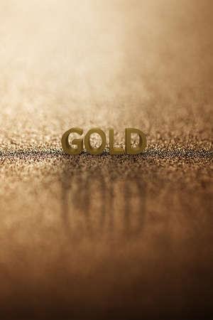 Alphabet gold word block with gold background. 3D rendering. 版權商用圖片