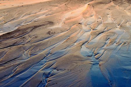 Low tide sand ripples at Sunset Stock Photo