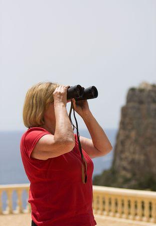 Shot of a Senior Lady looking through Binoculars photo