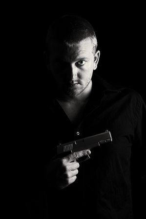 hitman: Shot of Menacing Male with Gun to Chest