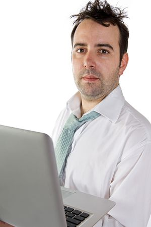 glum: Shot of a Messy Business Man Holding Laptop with Glum Look on Face Stock Photo
