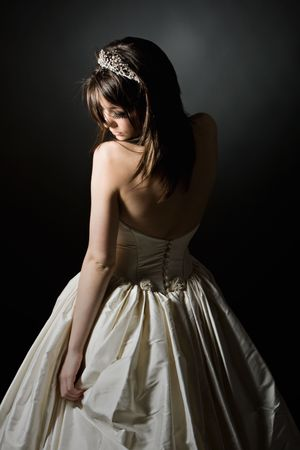 Low Key Shot of a Stunning Teenage Bride photo
