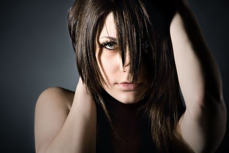 poignant: Studion Shot of Moody Teenager on Grey Background Stock Photo