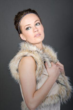 Shot of a Pretty Brunette in Fake Fur Gillet photo